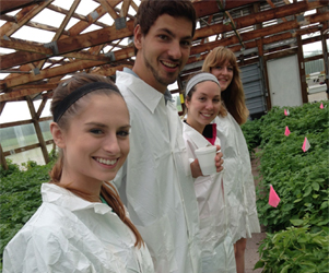 Touring the greenhouses at the State farm
