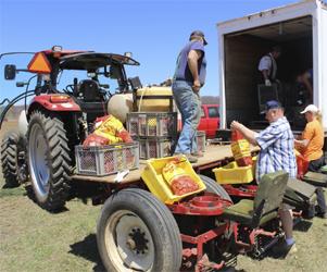 Jerry Kuczmarski, Jim Meyer and Dianne Kessler getting the planter ready